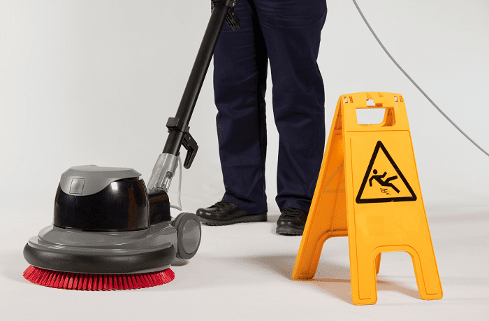 Man cleaning the floor with a machine